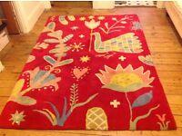 Wool pile floor rug