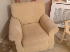 A pair of beige armchairs