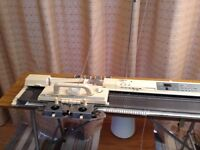 Brother Knitting Machine with full instructions, patterns, table and various cones of wool.