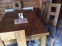 Extending dining table and 6 chairs - excellent quality