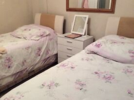 Two single beds with drawers