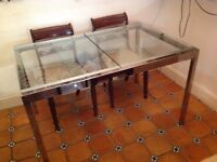 Extending Glass top dining table - seats 8 people when extended.