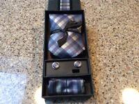Silk tie,cuff link and hankie set.