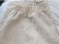 Cream fully lined curtains