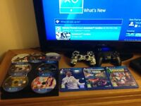 PS4 console, with two controllers and ten top games.