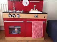 John Lewis red toy kitchen.