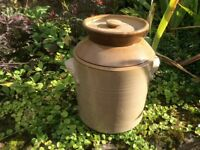 Four antique one gallon stoneware pottery lidded pots.