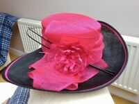 Stunning hot pink and black wedding/occasion hat.