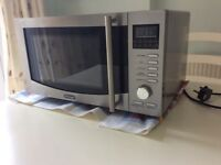 Microwave/Grill/Convection Oven by DeLonghi 900watt