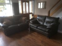 Brown leather sofa x 2 one is recliner
