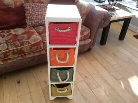Storage unit with multicoloured baskets in good condition