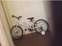 Child bicycle with stabilizers
