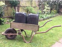 Converted wheel barrow, carries two 20 litre water containers which our included.