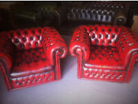 Pair of oxblood red leather chesterfield club chairs