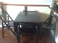 Wooden dining table and five chairs.