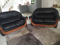 Two Good quality leather and wood sofas
