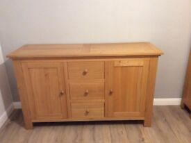 Light oak sideboard it has 3 cupboards in the middle,then 2 doors 1 either side nice condition