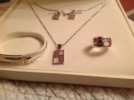 Solid silver all hallmarked ring - bangle - pendent & chain - earrings. Never worn £50 can deliver