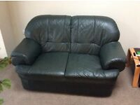 2 Seater Sofa, dark Green Leather. Free collection from nr Bedworth