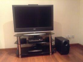 """Sony Bravia 40"""" tv; home cinema system & black glass and chrome tv stand"""