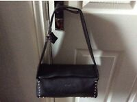 Black BULAGGI BAG in very good condition. Wide shoulder strap small stud detailing.