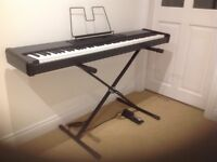 Roland RD150 electric piano with stand. 88 weighted keys. Damper pedal.