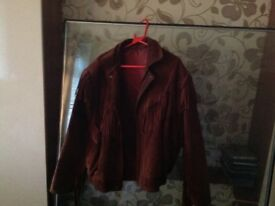 Suede jacket with tassels down arms across back, vgc fully lined popper fastening