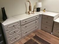 Ivory colour bedroom units featuring corner storage, drawers and two bedside units