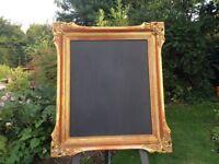 Vintage gold frame chalk board and easel great for wedding venue