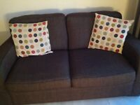 Brown two seater sofa bed in excellent condition with cushions to match to be collected
