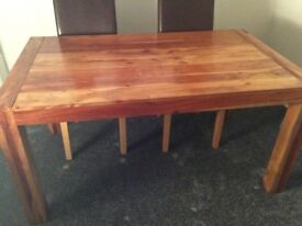 Solid acachia wood dinning table and four chairs 1.5m long 0.9mwide 0.75m high £150 ono