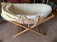 Moses basket with 2 stands.