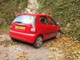 Kia picanto ,Red in good clean condition,petrol,hatch back.