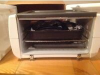 Reduced Again compact cooker four grill