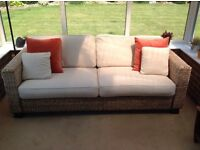 Rattan settee. Three-seater. Ideal for conservatory and in excellent condition.