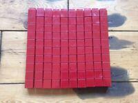100 Unifix Blocks. Maroon in colour.