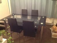 Black glass dining table & 4 Black chairs