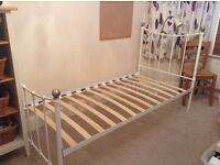 Single white metal framed bed