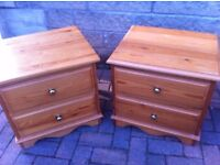 Matching pair of pine bedside drawers with brass handles