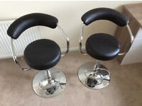 Two Faux leather and chrome finish bar stools