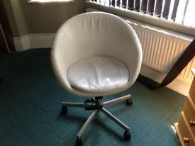 White faux leather swivel chair on wheels