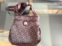 Small DKNY cross the shoulder bag, used once like new with dust bag lovely bag