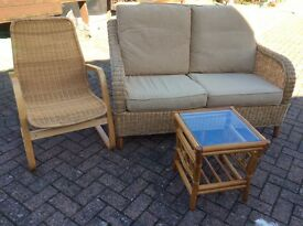 Cane settee,chair and glass top cane table,very good condition