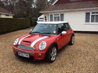 Striking, low mileage Mini Cooper S, chilli red with white stripes and roof.