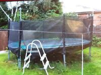 14ft trampoline and enclosure. Pads replaced last year