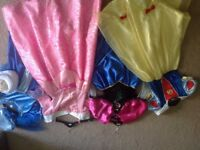 Four girls fancy dress up outfits aged 6-8 including Snow White, aurora, Anna and mary