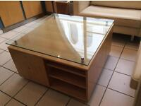 Large coffee table with storage and toughened glass top.