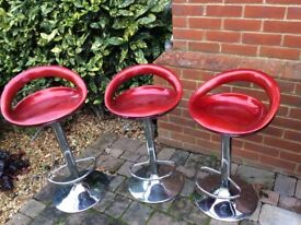 3 Red Swivel Bar stools