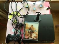 PlayStation 3 PS3 slim with Modern Warfare 2, console cooler, official Bluetooth earpiece & HD cable