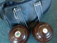 Pair of crown green bowls.